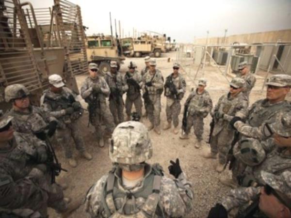 """خبراء: إرسال أمريكا قوات عسكرية إلى العراق """"احتلال ثان"""""""